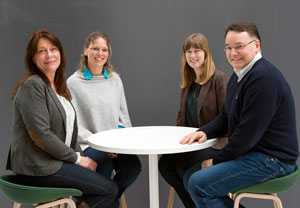 Phot of four people around a table: From left: Head of Section of Administrative Services in the faculty administration Anita Robøle, head of administration at NCMM Elisa Bjørgo, head of administration at BiO Ingrid Kjelsvik and the Centre Director for BiO and NCMM Kjetil Tasken.