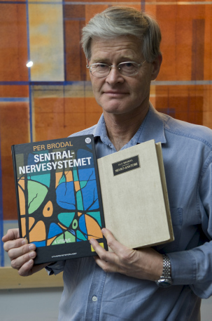 Per Brodal with his book 'The Central Nervous System`