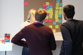 Three persons discussing a project.