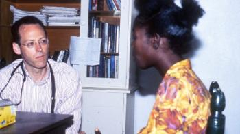 Doctor Paul Farmer talking to a woman
