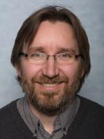 Image may contain: Glasses, Hair, Facial hair, Forehead, Beard.