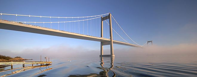 Bridge in a sea of fog. Blue sky.