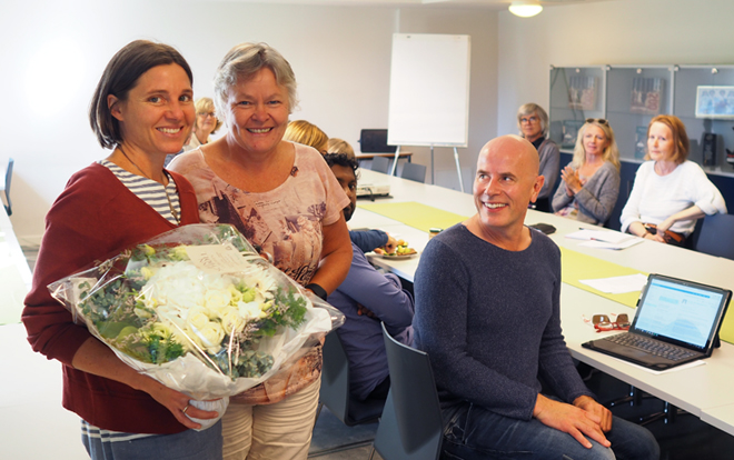 Ruth Prince receives flowers from the Institute