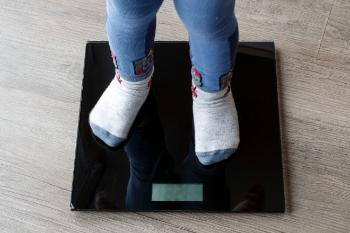 Child on a weight scale.