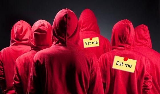 """seks personer i rød hettegenser, sett bakfra. To av dem har merkelapp på ryggen der set står """"eat me""""."""
