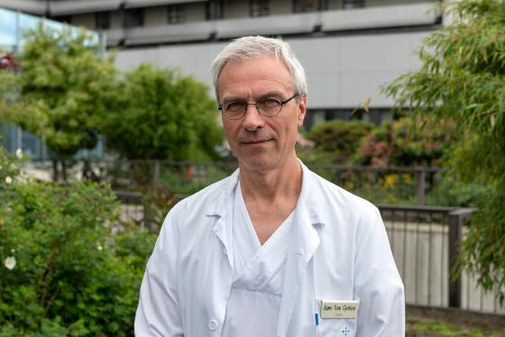 Photo of Bjorn wearing white lab coat